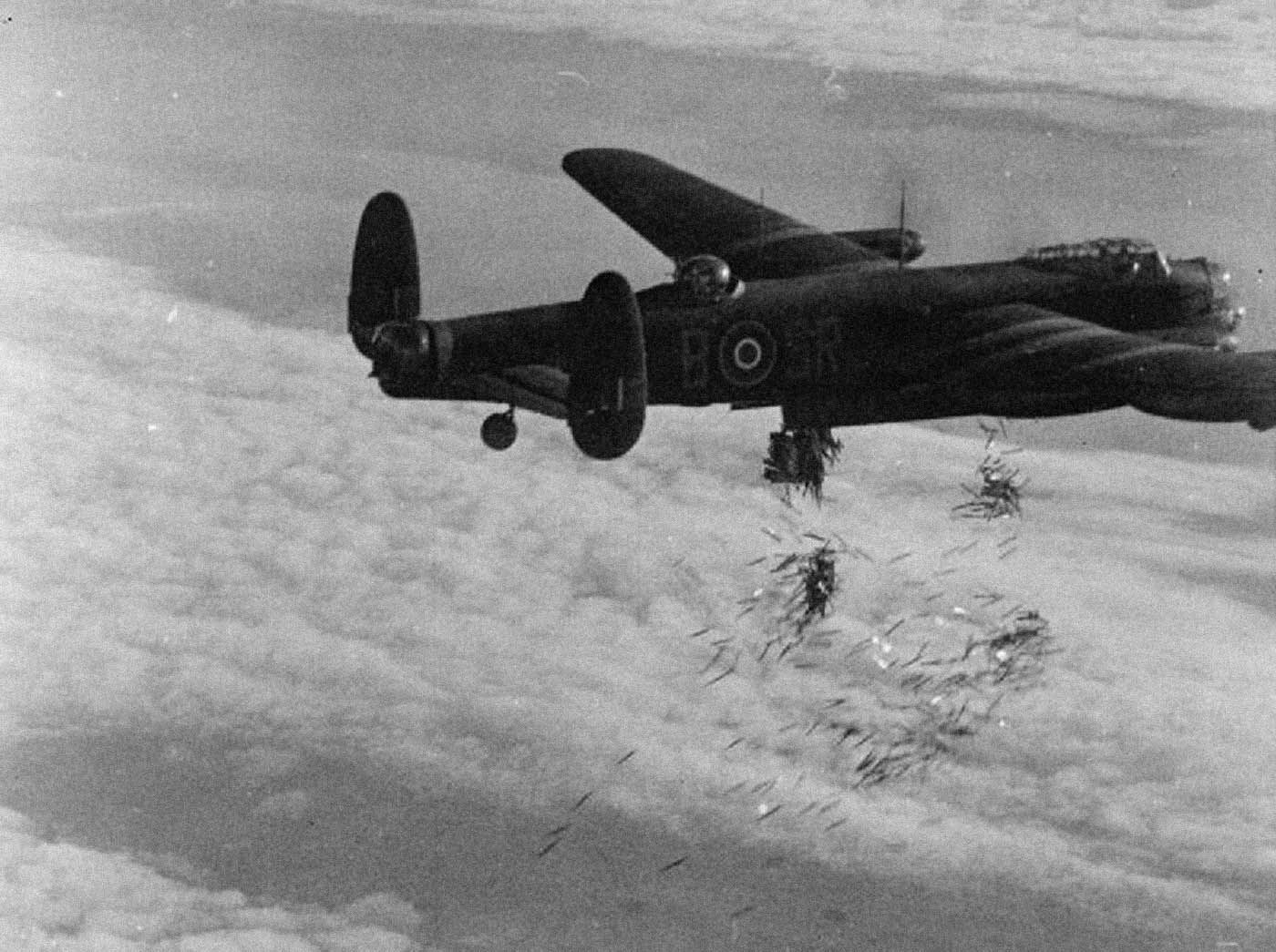 """An RAF Avro Lancaster drops """"Window"""" chaff. These clouds of aluminum strips  showed as false echoes on German radar … 