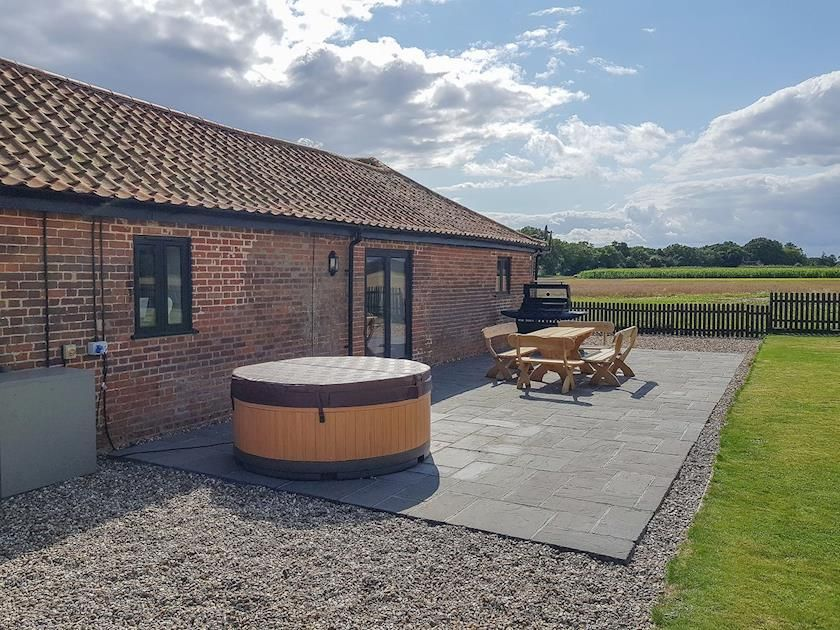 Private Patio With Hot Tub Summer House Stables Catfield Near Stalham With Images Summer House Private Patio Patio