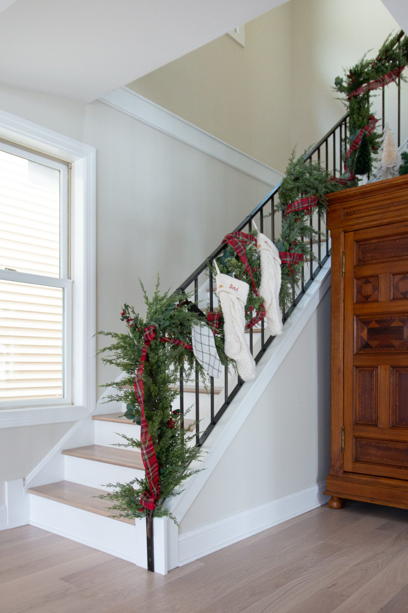 Come take a look at my simple 2019 Christmas home tour. I have two trees, a staircase with faux garland, a Christmas window box, and more! #christmasdecor #christmashome #holidayhome
