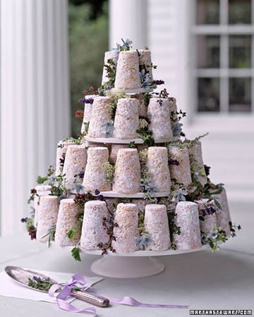 Rustic French Provencal Cake... Crottin cakes in the shape of French goat cheeses are stacked on a wooden stand to mimic a tiered cake. Flowers such as Queen Anne's lace and tweedia are paired with rosemary, lavender, and oregano to capture the romance of the French countryside.