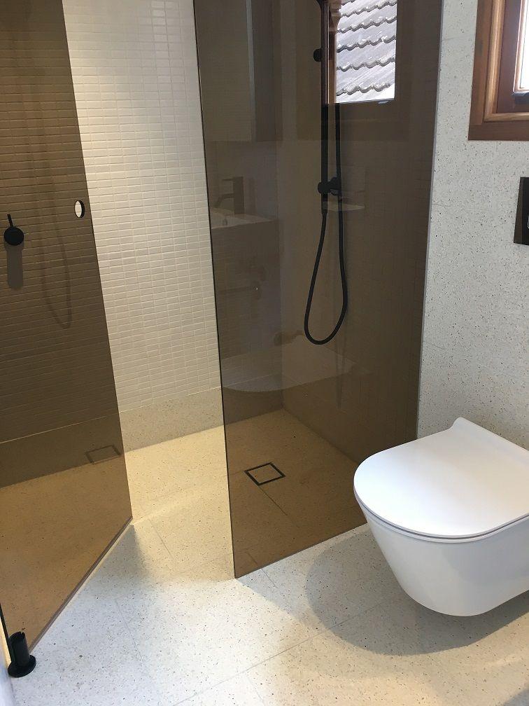Frameless Pivot Shower Screen Matte Black Fittings And Tinted Glass Shower Screen White Bathroom Glass Shower