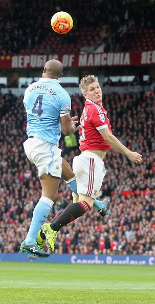 Bastian Schweinsteiger of Manchester United in action with Vincent Kompany of Manchester City during the Barclays Premier League match between...