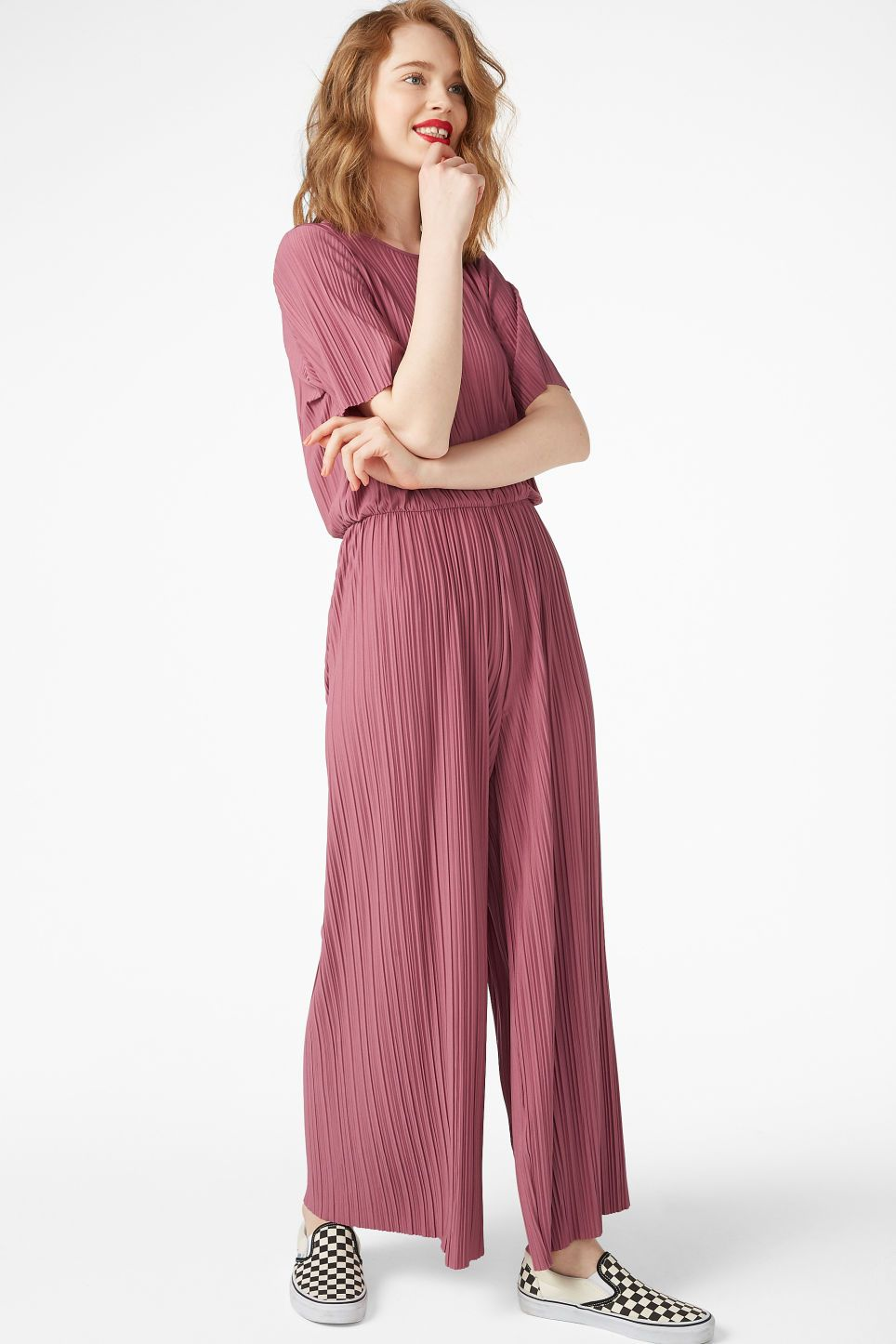 dd063c4e3ff A pleated jumpsuit with a classy fit and an elastic band in the waist.  Let s stay comfy while looking classy!