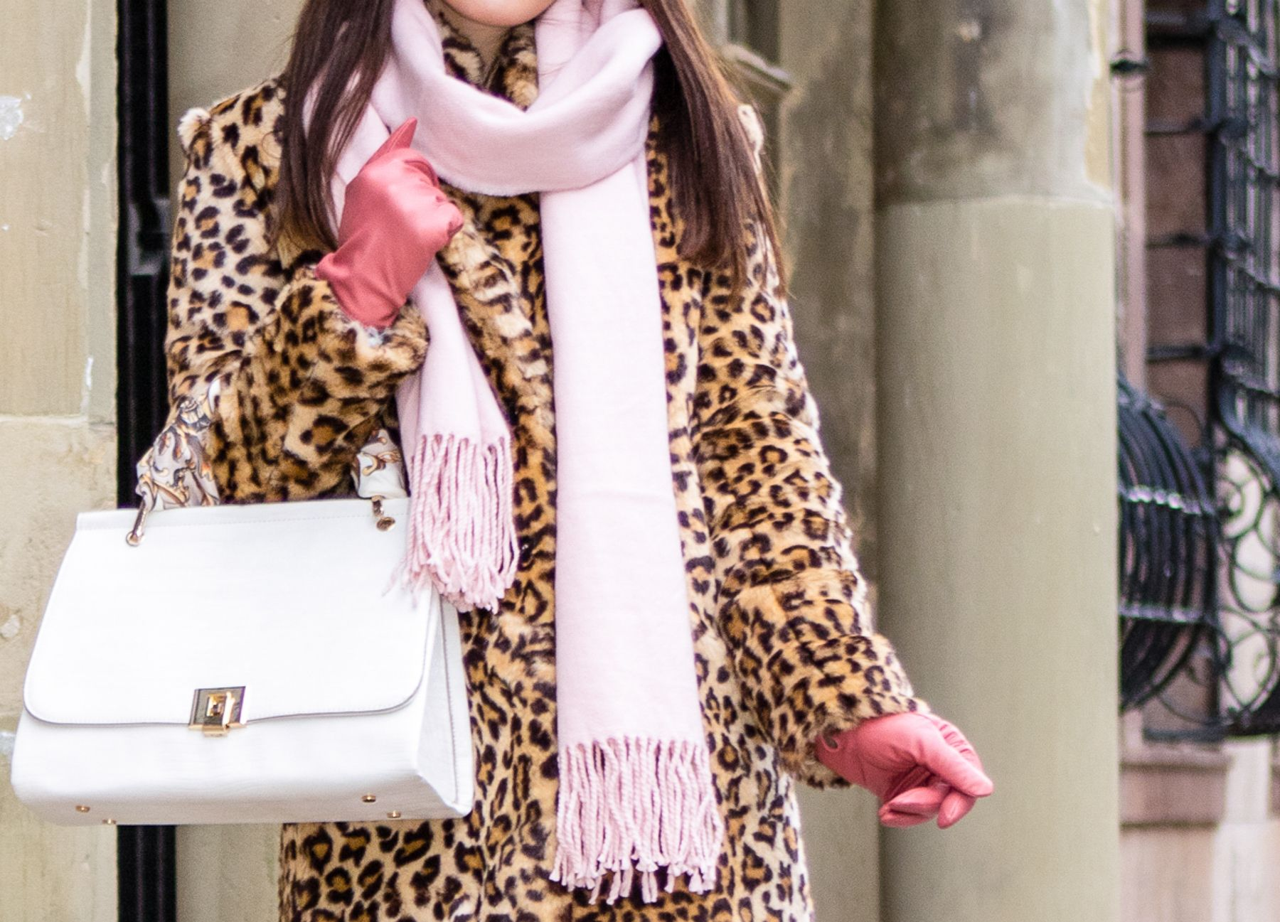 Outfit details: leopard fake fur coat by Zara, pink scarf by ASOS, pink leather gloves by H&M, white tote bag by Zara http://www.thefashionrose.com/2016/12/make-a-statement-this-winter-wearing-a-leopard-coat.html