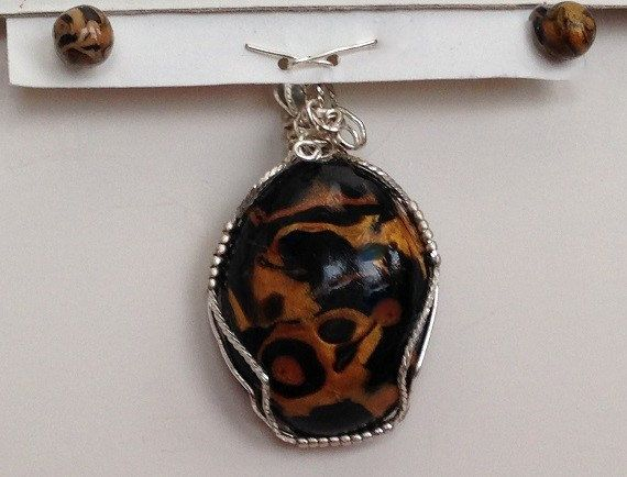 WP/E035 Wire wrapped jungle print pendant and by MMJWDesigns