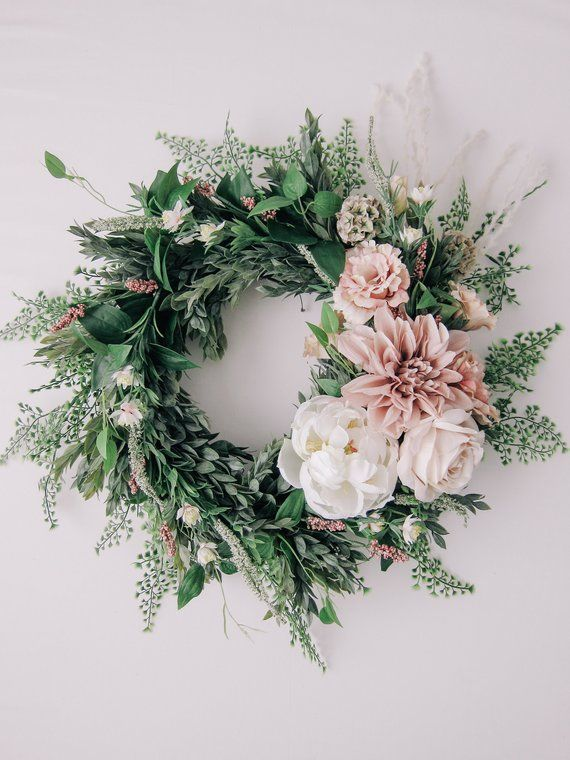 Get inspiration here to make 20 Affordable Spring Wreaths and Garlands.