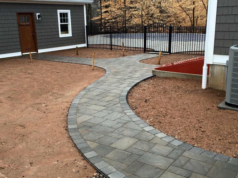 Nice Walkway From Pool House To Garage And Driveway.