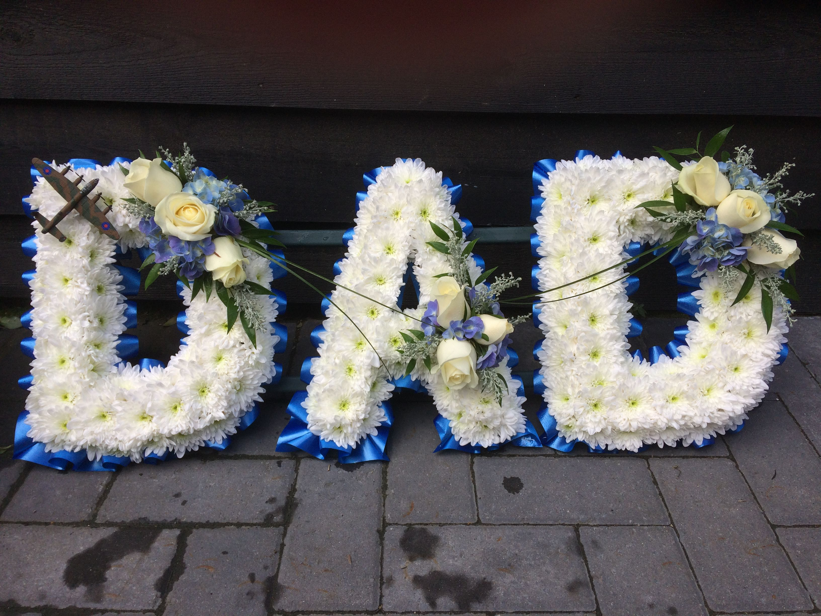 Dad funeral letters, white basing, blue and white sprays