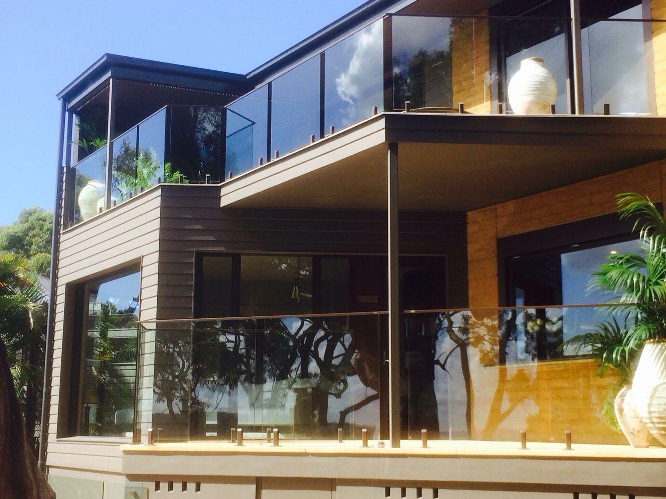 Altezza Dei Parapetti frameless glass balustrade with stainless steel spigots a