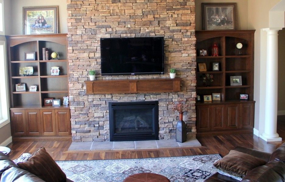 Stone Fireplace Mantels With Side Shelving Unit And Rectangular Floral Pattern Rug On Brown Harwood Floor A Fireplace Built Ins Living Room Built Ins Built Ins