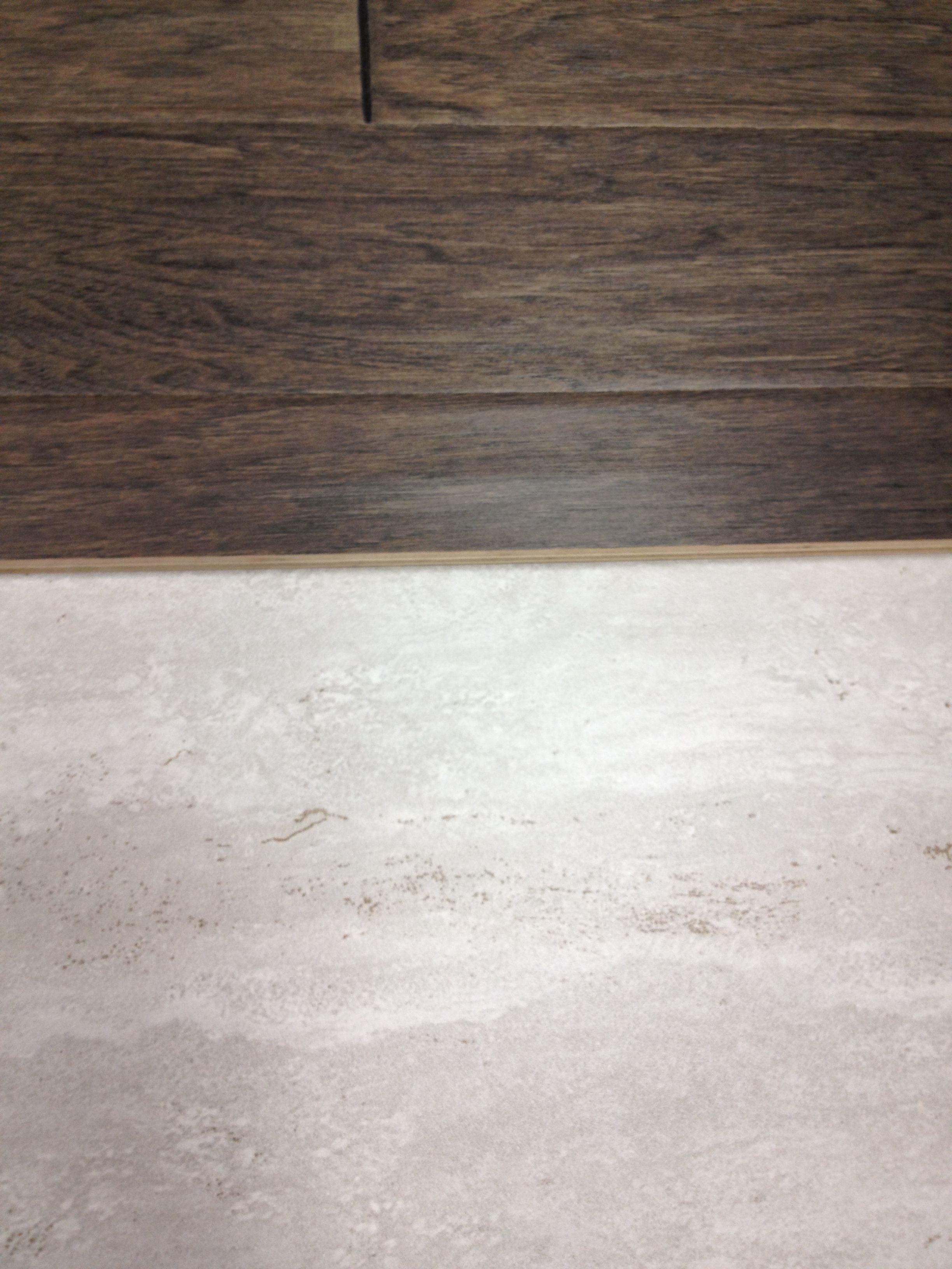 Grey Hardwood Floors Next To Light Grey Tile Small Remodel