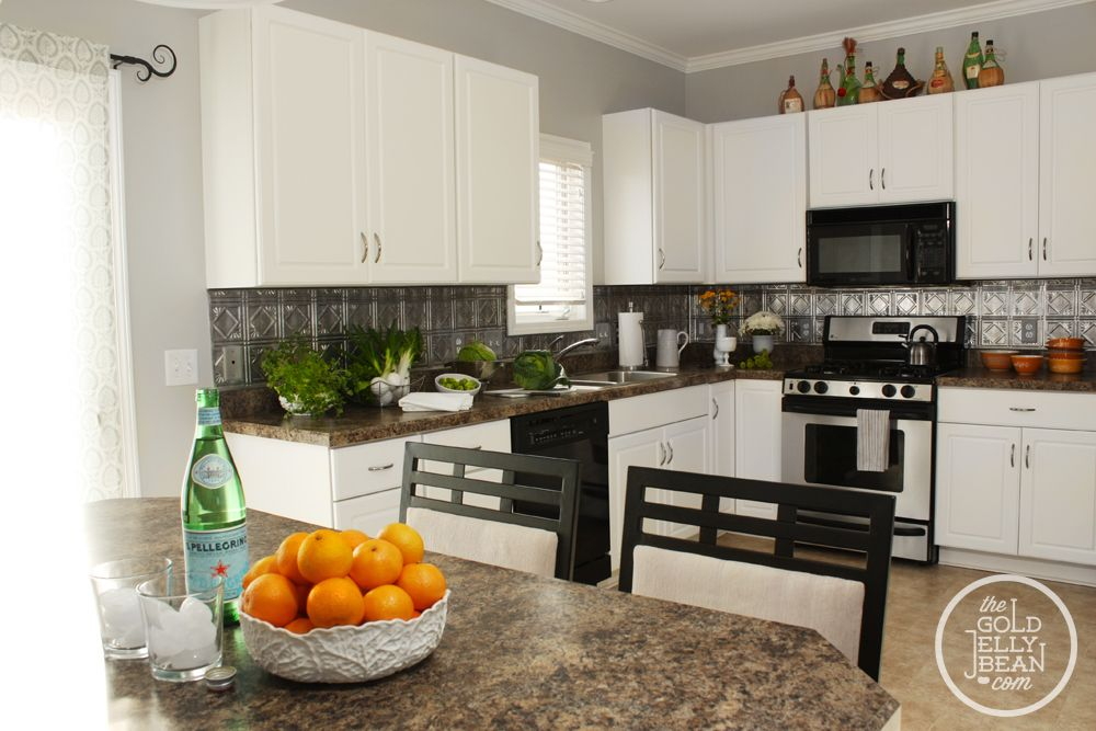 Planning to put up this faux tin tile backsplash up in my kitchen ...