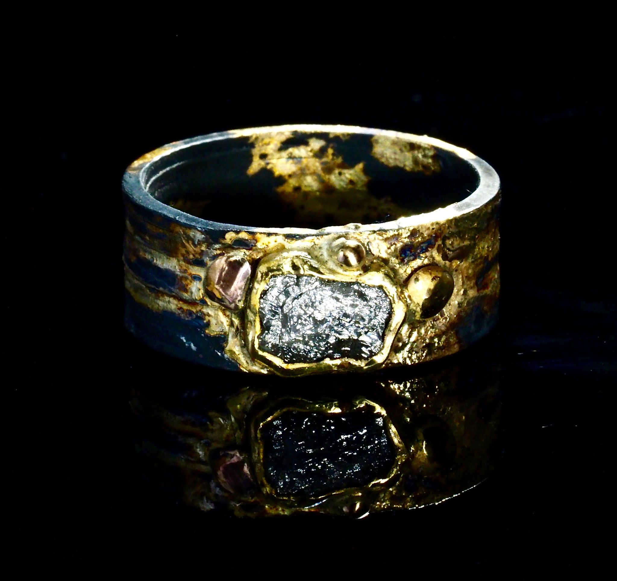 with diamond surrounding engagement raw a layered the an rings pin large it is gold ring shank silver best and bezel oxidized set in boulders