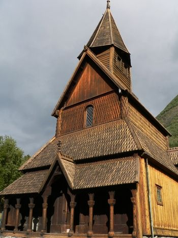 Since I've seen it in real life, I can tell the church is overwhelming and has beautifull wooden and glass art on the inside.  Info: Urnes Stave Church,Norway.The wooden church of Urnes (the stavkirke) stands in the natural setting of Sogn og Fjordane. It was built in the 12th and 13th centuries and is an outstanding example of traditional Scandinavian wooden architecture. It brings together traces of Celtic art, Viking traditions and Romanesque spatial structures.