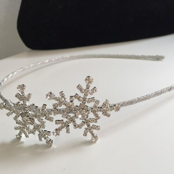 A perfect headband for any winter occasion This show stopping piece is handmade using quality componants.  This side tiara is truley stunning on .