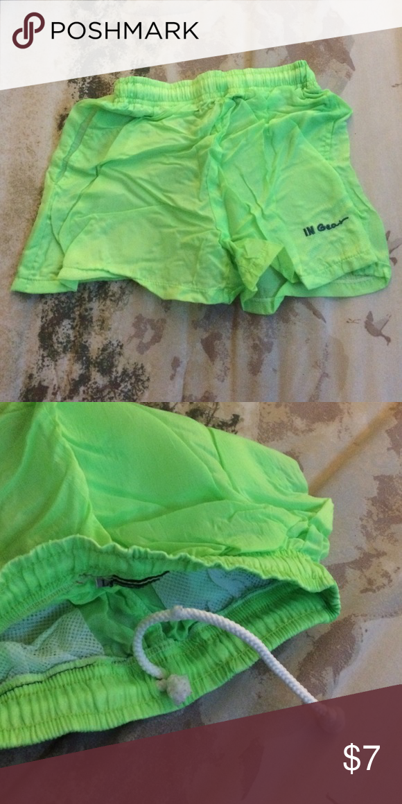 Lime green swim shorts Never been worn, has pockets on both sides, drawstring works but is lopsided some. Very thin material and would recommend to wear something underneath it. Bottoms Shorts