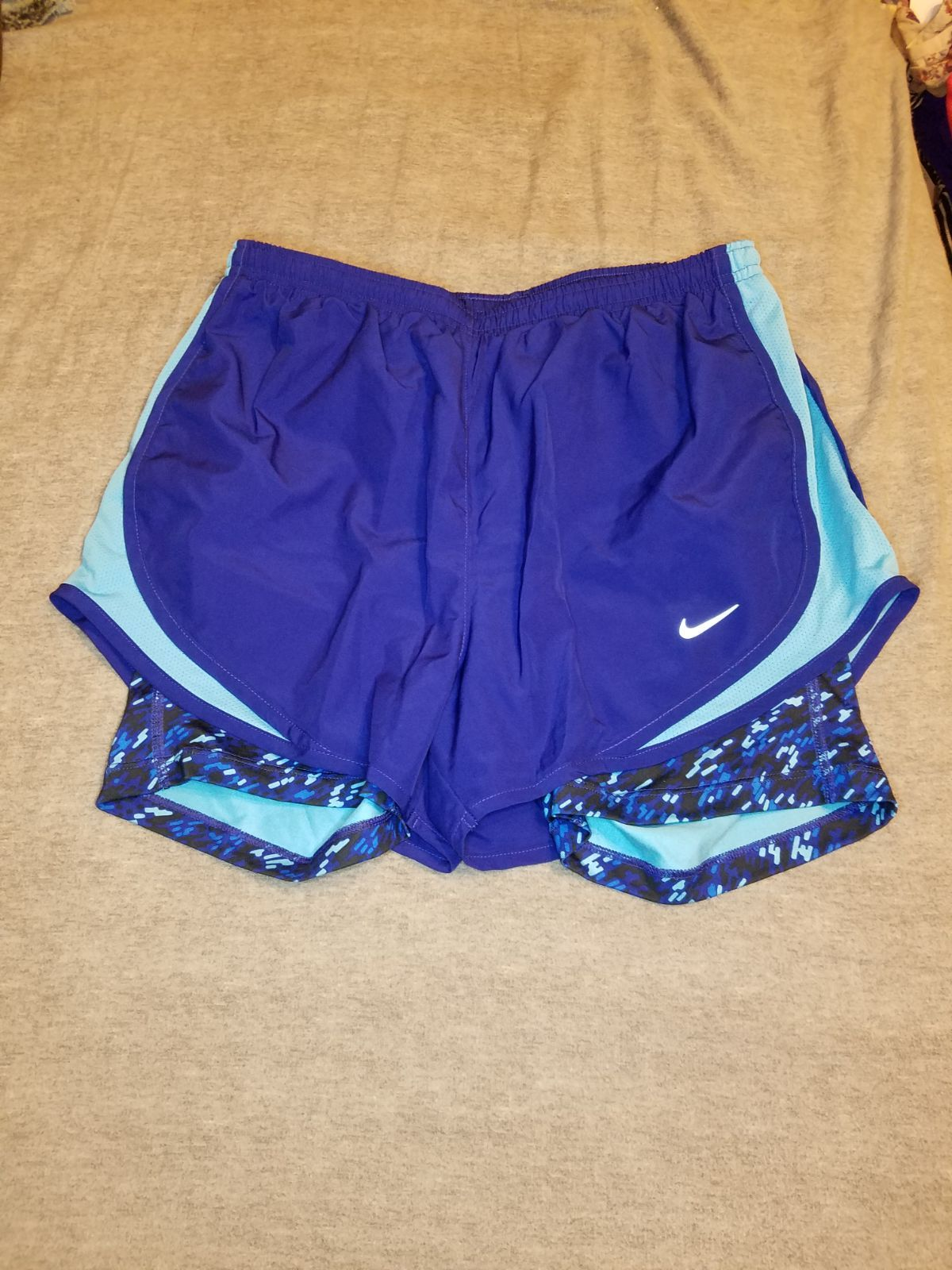 Blue nike dri fit tempo running shorts with light blue