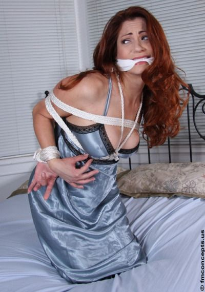 She HOT silk and satin bondage grips tight