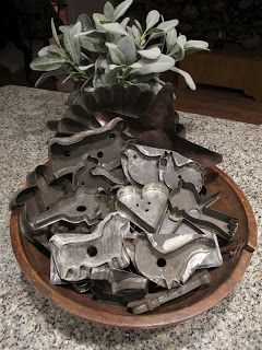 Nice old bowl with repair and prim tin cookie cutters.