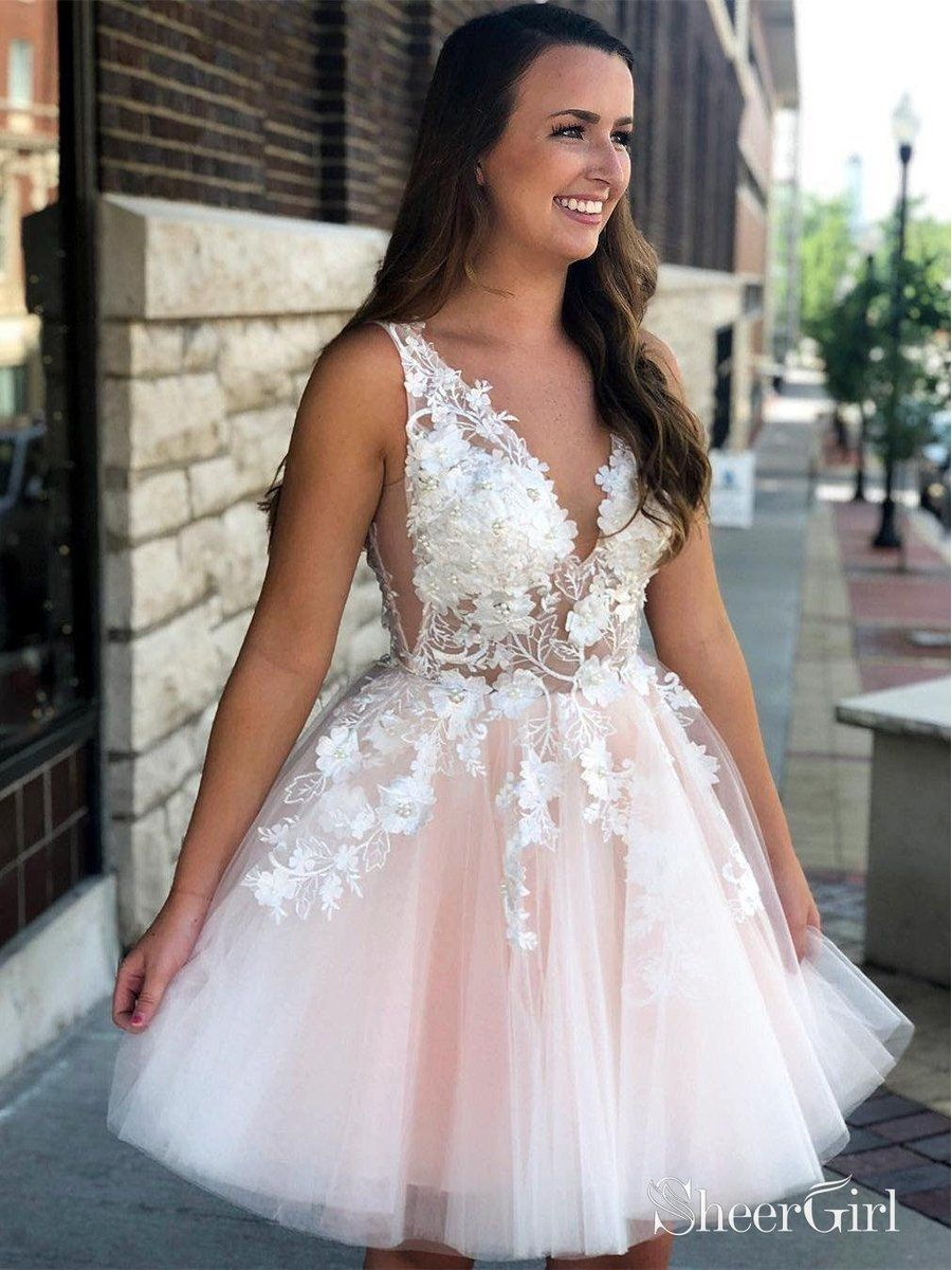 2bd4f2f646e This beautiful blush pink prom dress features v-neckline and lace applique  climb from the skirt to the bodice with tiny pearls. Back with zipper  closure and ...