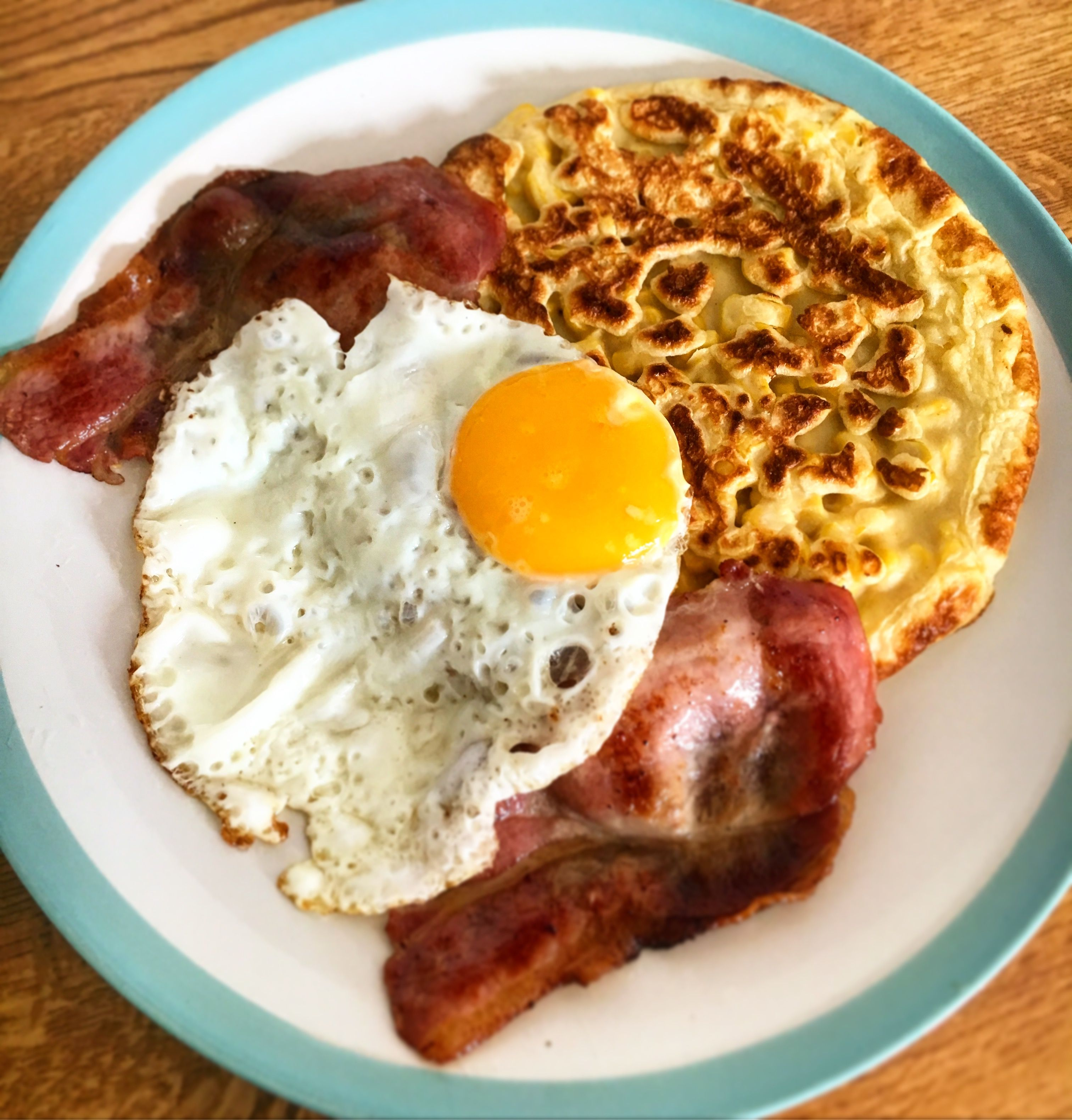Giant sweetcorn fritter with bacon and egg