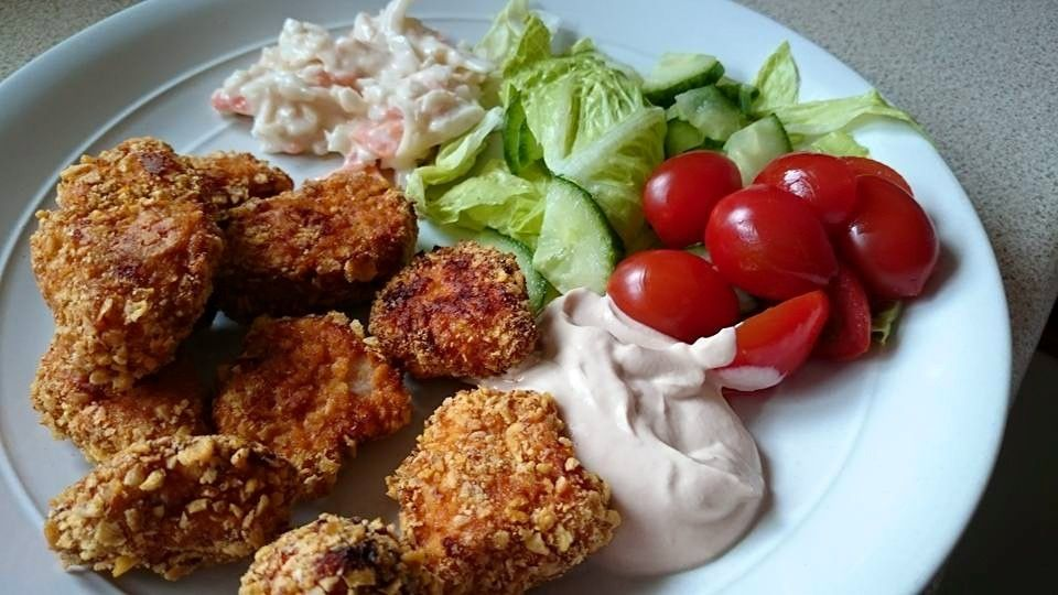 Tasty, crispy homemade chicken nuggets with a homemade lemon Marie Rose sauce