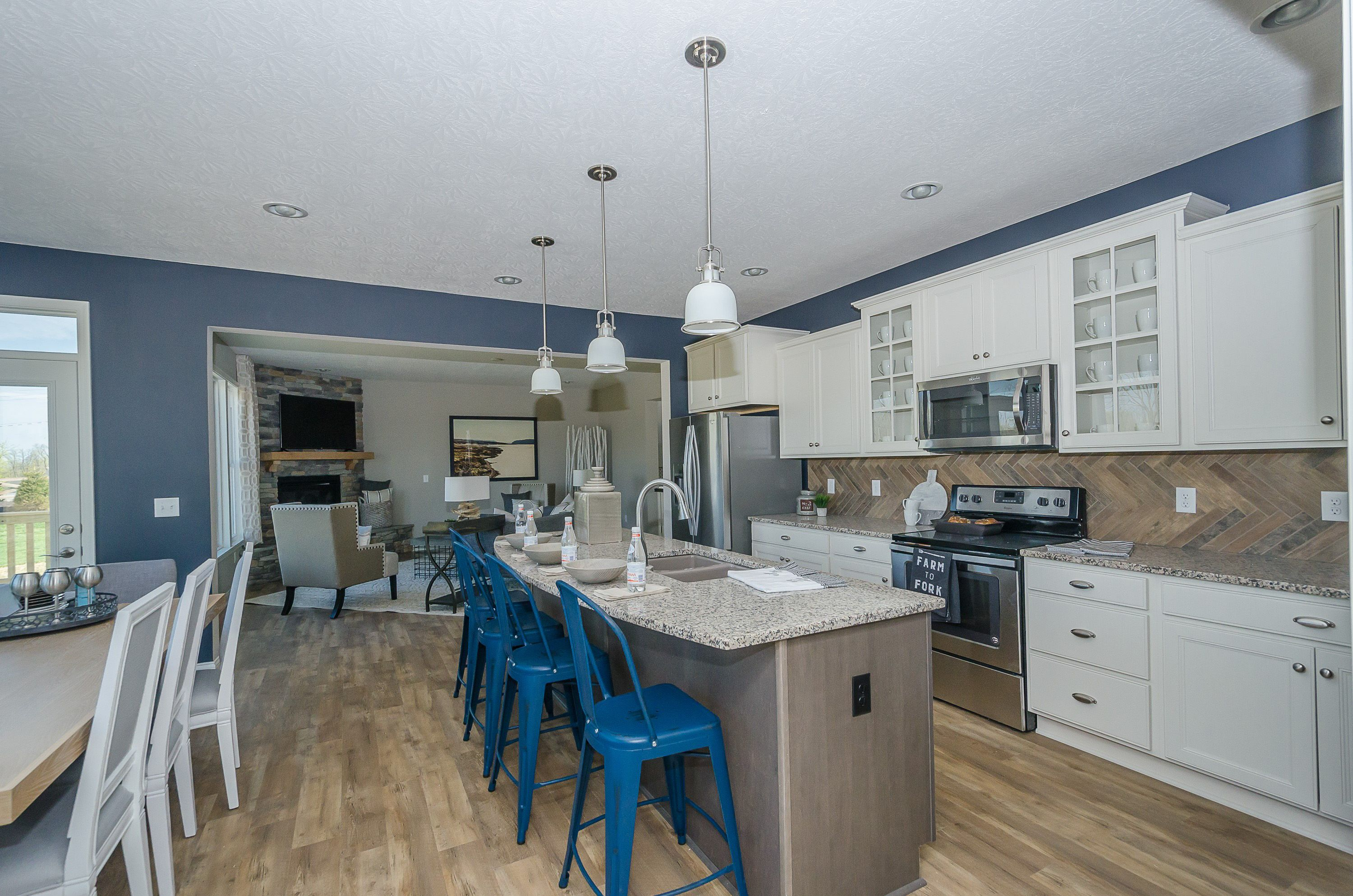 Add Some Contrast To Your Kitchen By Adding Blue Accent Pieces Like These  Bar Stools To Your Beautiful And Functional Island. Seen In The Quinn At  Wynstead ...