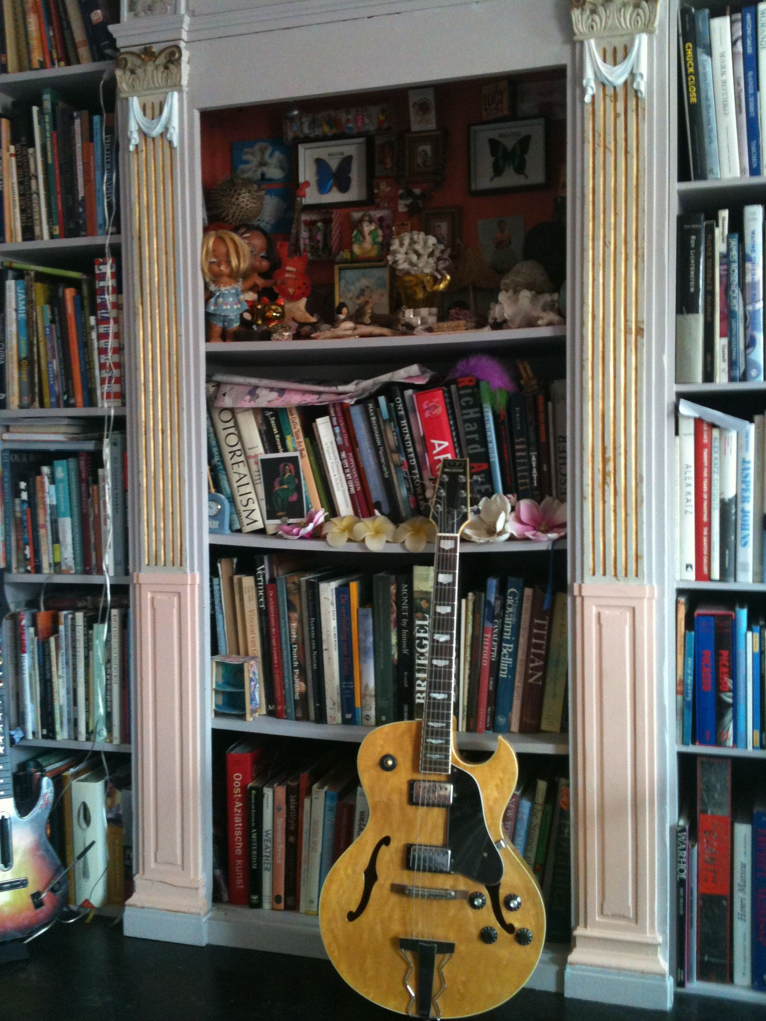 books and a jazz guitar