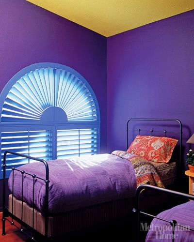 Bright Violet Painted Bedroom Walls With Mustard Ceiling In