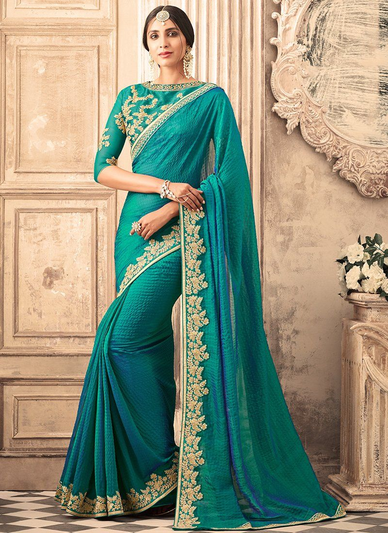 f3181af10af1f7 Turquoise and Gold Embroidered Silk Saree features a beautiful silk saree.  Embroidery work is completed with zari