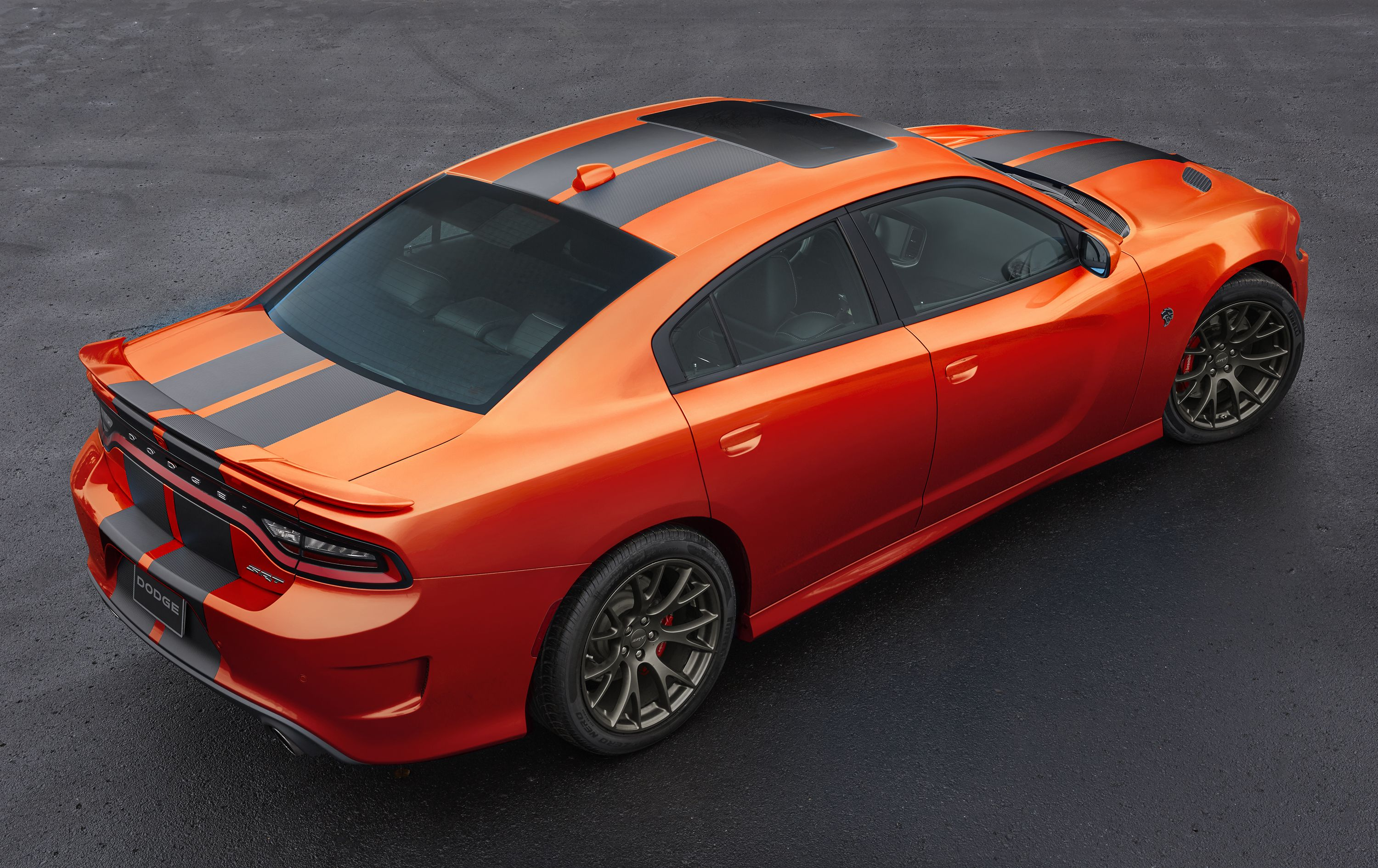 Dodge expands its color palette with a new modernized version of go mango exterior paint on 2016 dodge charger srt models