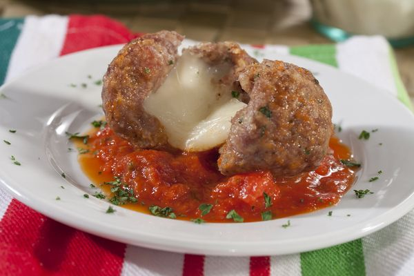 {Cheesy Stuffed Meatballs} Take a bite out of these easy-to-stuff meatballs and enjoy the flavorful surprise of cheese oozing out of every tasty bite. Whether cocktail or main dish sized, our Test Kitchen guarantees these scrumptious Cheesy Stuffed Meatballs will never disappoint. | mrfood.com