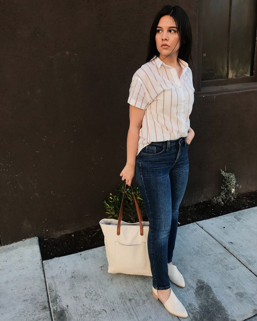 64905ecd32ae43 Target Universal Thread striped shirt, straight jeans, shoes, and purse.