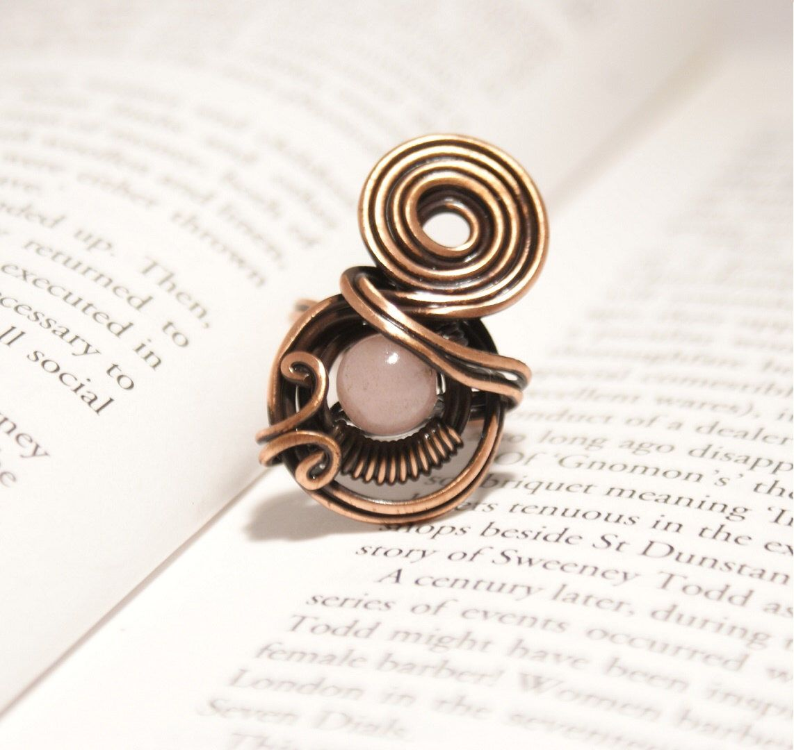 A personal favorite from my Etsy shop https://www.etsy.com/listing/248774447/copper-ring-rose-quartz-ring-wire