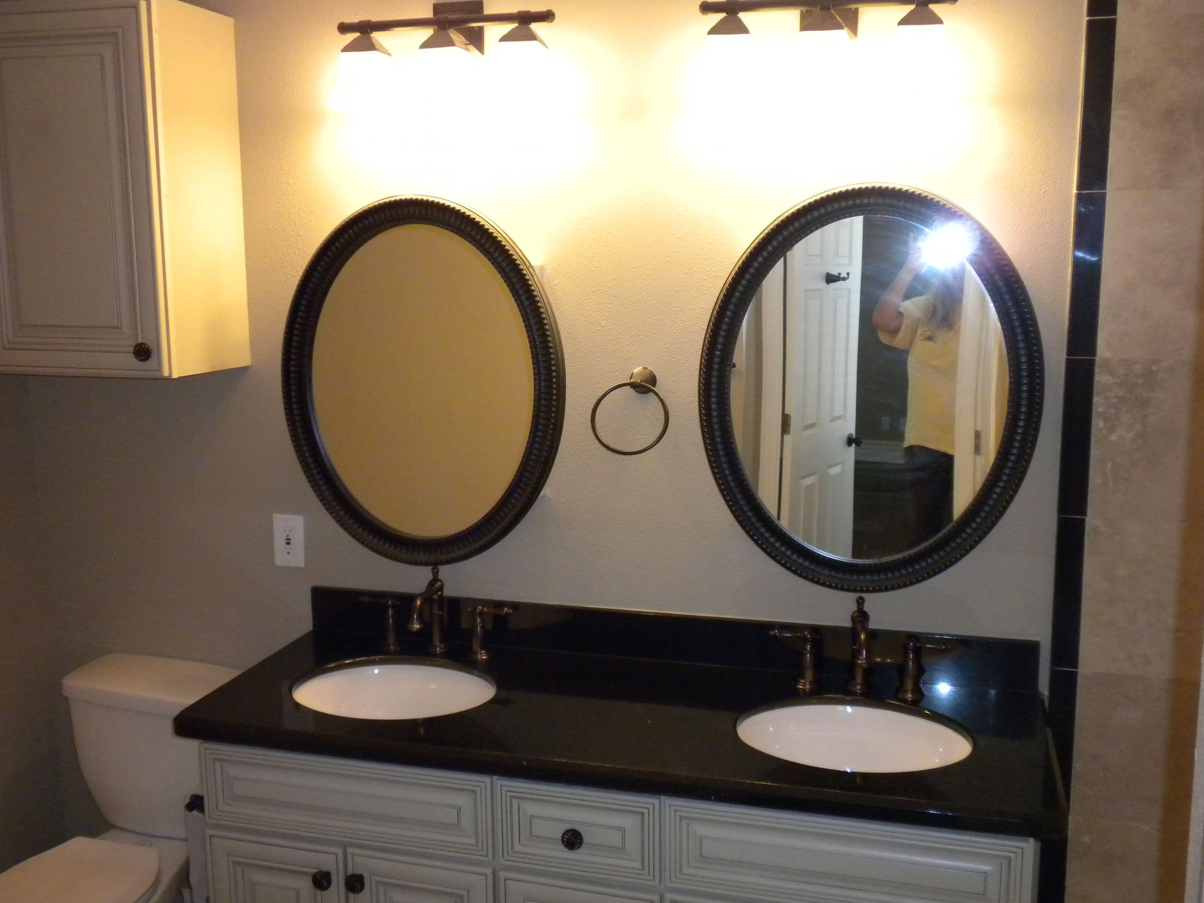 White Cabinets with Chocolate Glaze Black Granite Oil Rubbed
