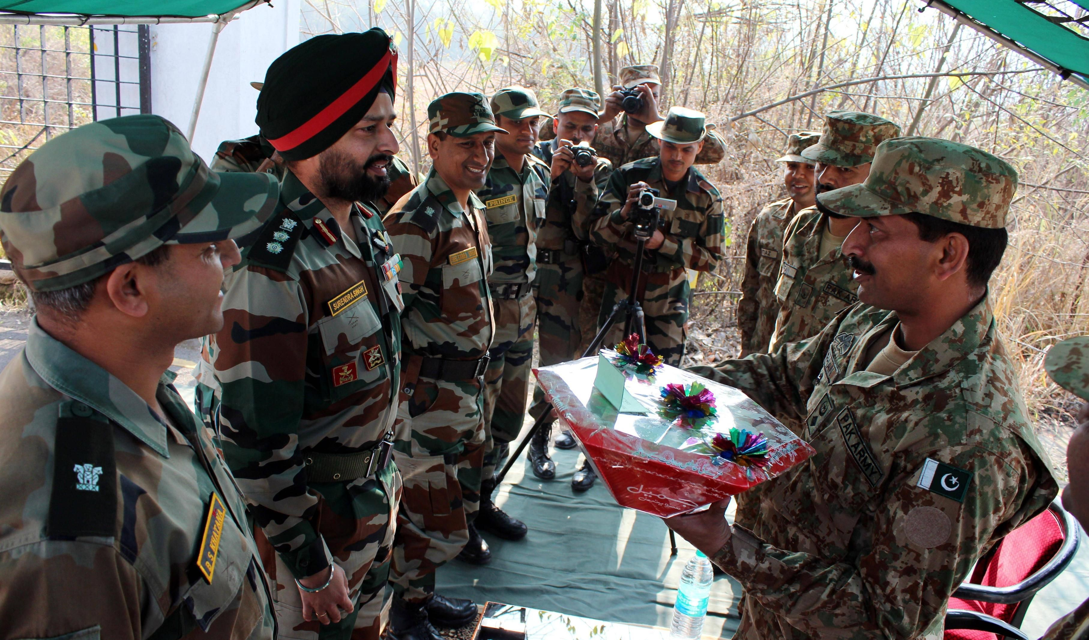 An Indian Army Col  and a Pakistan Army Lt  Col exchange gifts