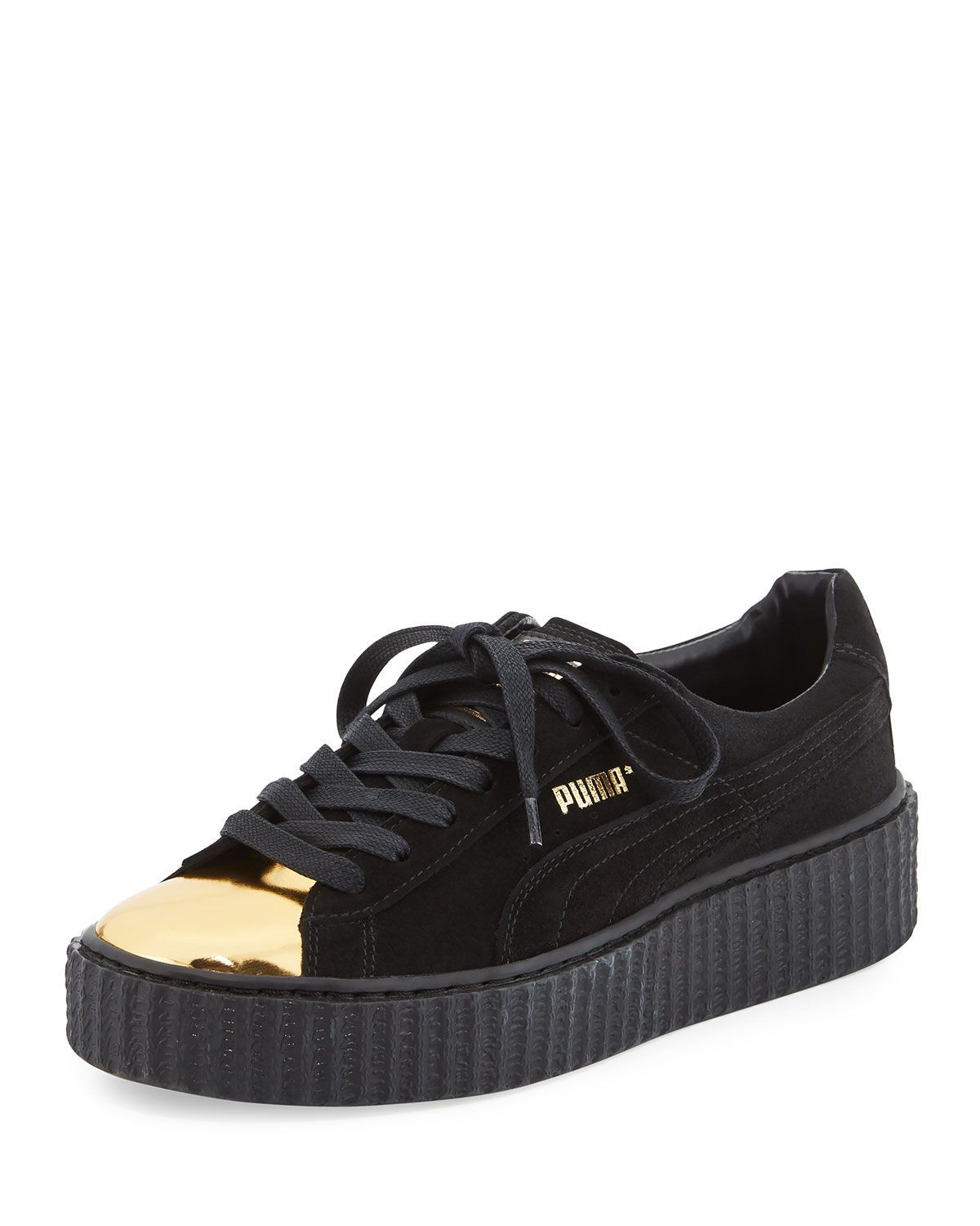 496b29489f5a Puma suede creeper low-top. 1.3 platform heel. Patent leather cap toe. Logo  patch on tongue. Embossed logo at side and backstay. Lace-up front.