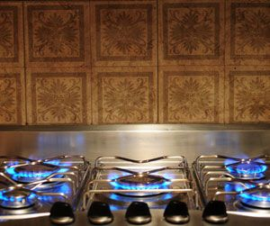 How to remove grease from backsplash stone tiles