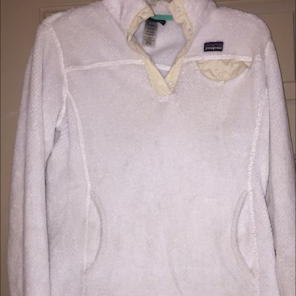 Patagonia fleece pullover this is a used white fleece Patagonia pullover. it looks a little used but still in great condition and machine washable. it's a KIDS XL but fits an like an adult small!!! Patagonia Jackets & Coats