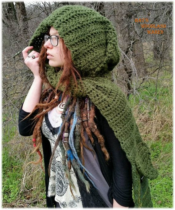 This hooded scarf features a double pocket with a horn closure, and ...