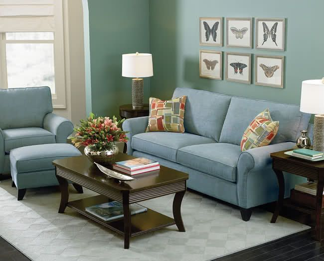 The Blue Green Wall And Light Blue Couch Create A Relaxing Space With The Cool Colors Green Sofa Living Room Green Living Room Decor Brown Living Room Decor