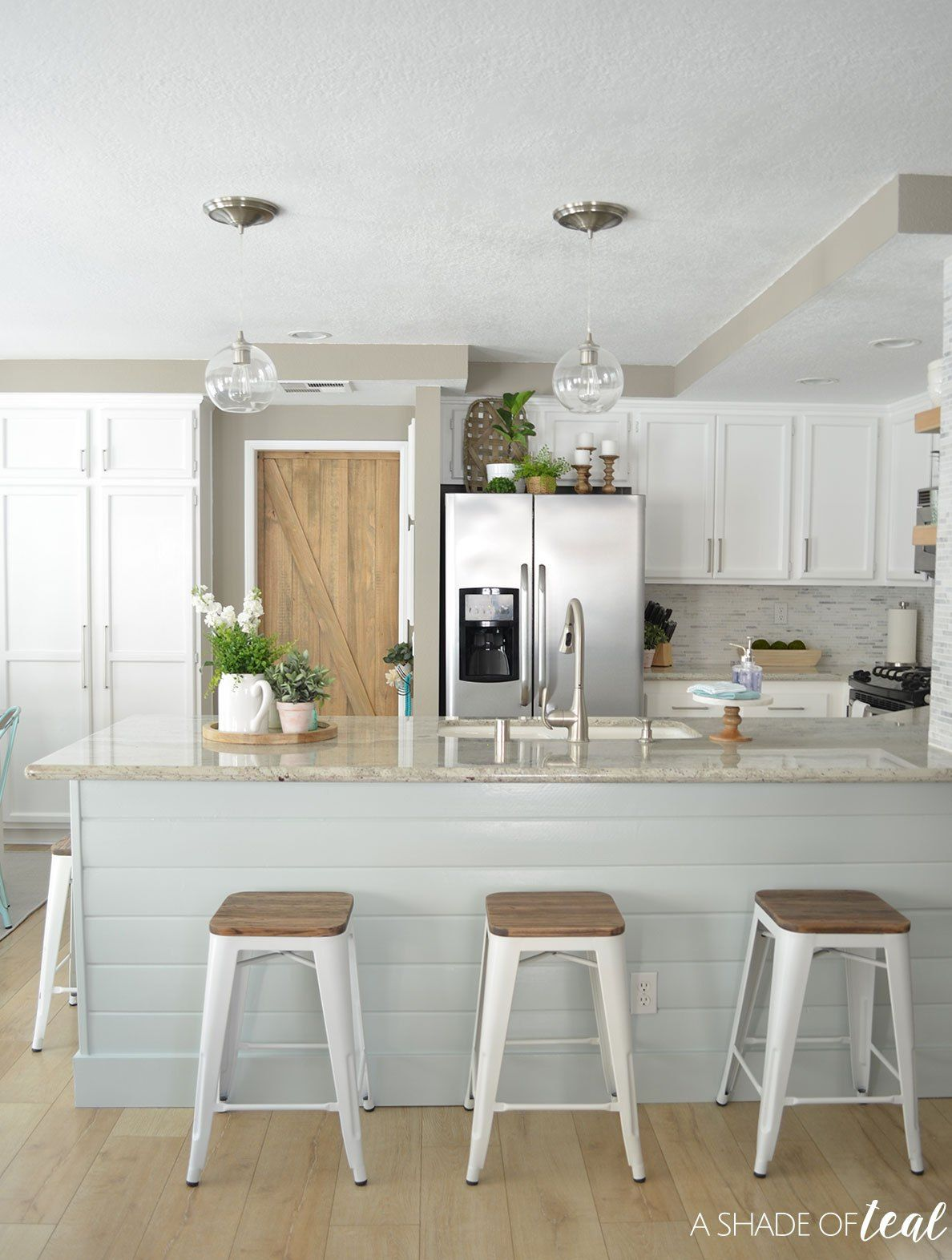 Modern rustic kitchen makeover love the metal bar stools get the look with the bristow collection by osp designs