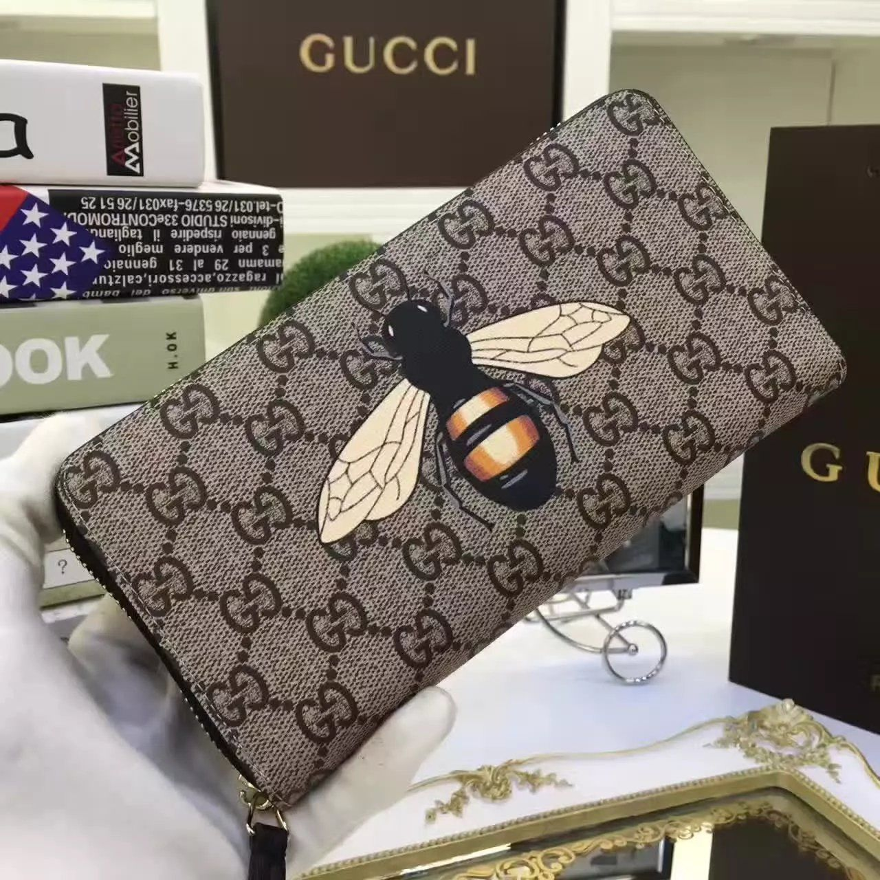 1e03f2b3d80d0f Replica GUCCI Bee print GG Supreme zip around wallet | Wallet ...