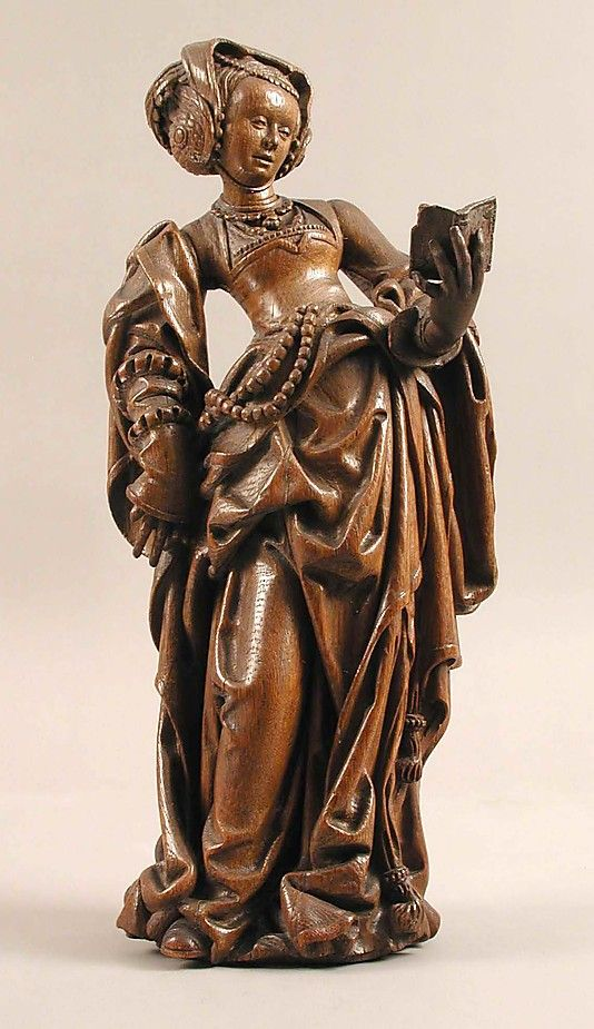 Female Saint with a Book    Date:      ca. 1520  Geography:      Made in, Calcar, Lower Rhine, Germany  Culture:      German  Medium:      Oak  Dimensions:      Overall: 18 11/16 x 8 1/4 x 6 5/16 in. (47.5 x 20.9 x 16 cm)  Classification:      Sculpture-Wood  Credit Line:      Gift of J. Pierpont Morgan, 1917  Accession Number:      17.190.726    This artwork is currently on display in Gallery 305