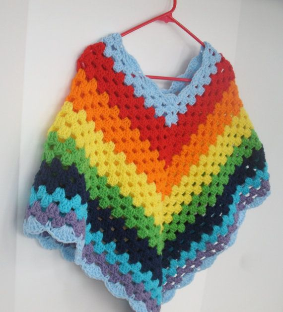Had a rainbow crocheted poncho that matched my mom\'s in the 70\'s ...