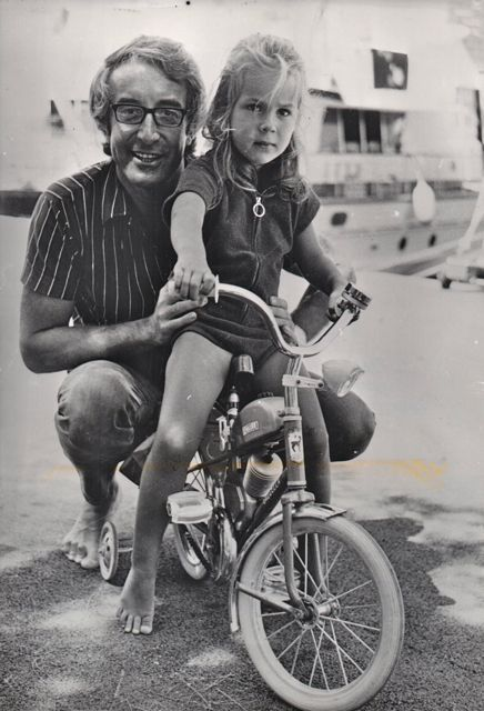 Victoria Sellers Rides A Bike Peter Sellers Stands By
