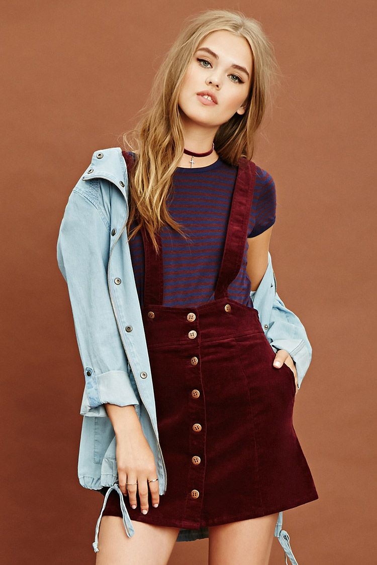 040668b85c78 A woven corduroy overall skirt featuring removable crisscross straps ...