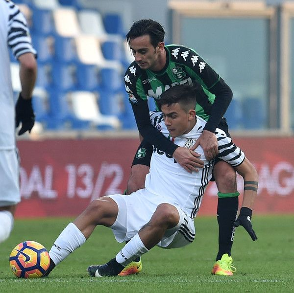 Alberto Aquilani of US Sassuolo and Paulo Dybala of Juventus FC in action during the Serie A match between US Sassuolo and Juventus FC at Mapei Stadium - Citta' del Tricolore on January 29, 2017 in Reggio nell'Emilia, Italy.