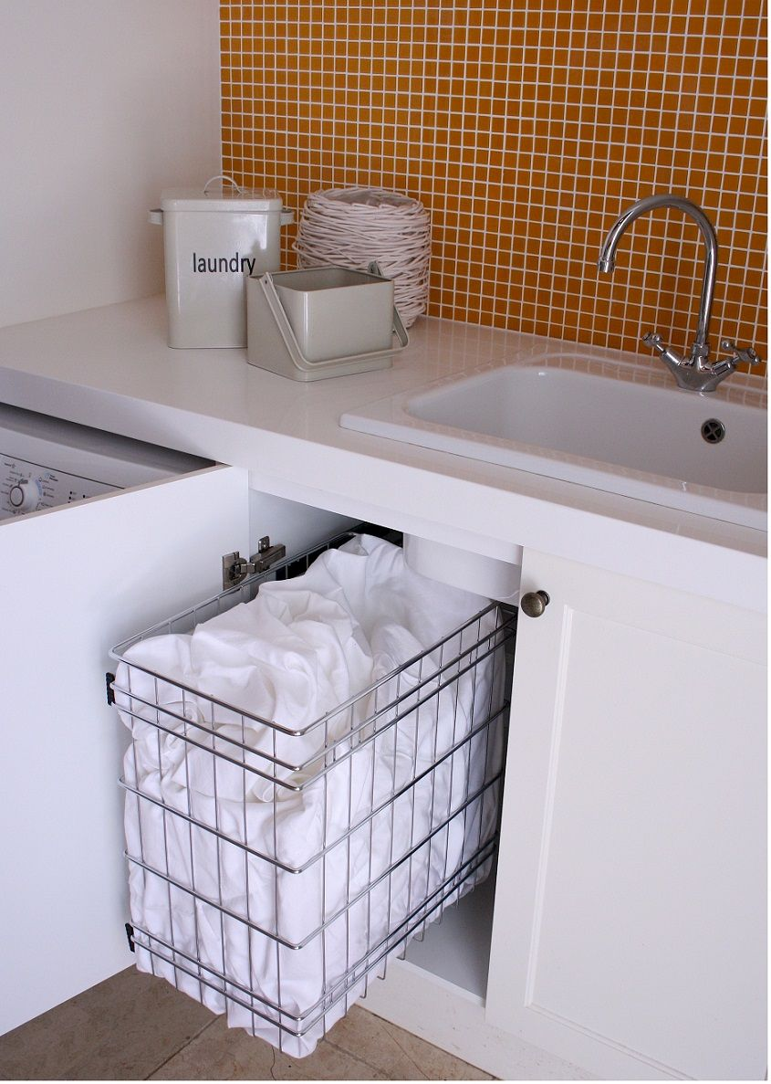 Create Functional Laundry Storage With Stainless Steel Pull Out