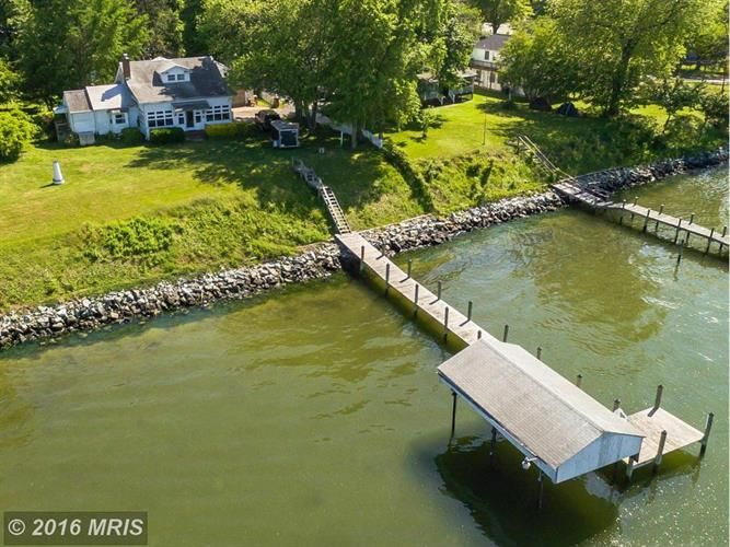 $449,900 - View 30 photos of this 3 Beds 2.0 Baths Bungalow home built in 1935. Incredible Patuxent River property with huge vista, on 2 lots! Watch sunris